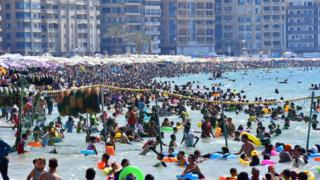 People gather at the beach in Egypt's northern coastal city of Alexandria on July 5, 2019.