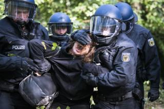 Police removing a protester in September 2018