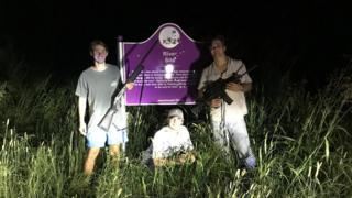Three Ole Miss students flank the sign honouring slain civil rights icon Emmett Till