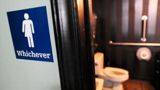 A gender neutral sign outside a toilet in the US (file photo)