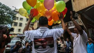 Friends of Kulbhushan Jadhav celebrating with balloons on the streets of Mumbai after hearing the ICJ's verdict