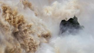 Huge volumes of water crash down the Barron Falls in Kuranda, Queensland