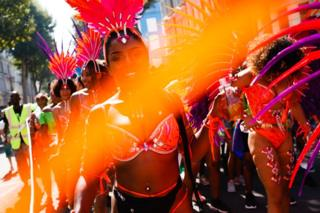 Revellers take part in the Notting Hill Carnival