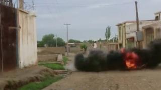 An explosion is seen during heavy firing between the Taliban and Afghan forces on a street in Kunduz