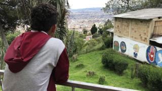 Luis stands on the balcony at Benposta