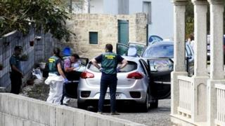 Officers inspect evidence at the scene of a triple murder in the area of Valga in Potevedra, Spain, 16 September 2019