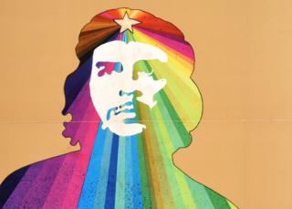An Ospaaal poster entitled Che Guevara, 1969, showing his face over a rainbow design